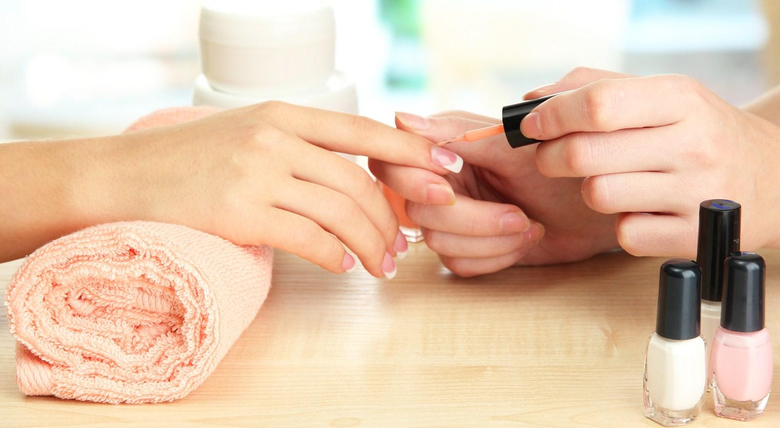 bigstock-Manicure-process-in-beauty-sal-38913112