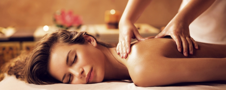 Young woman relaxing during back massage at the spa.